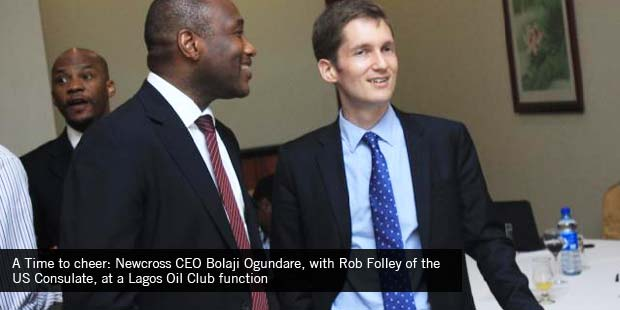 A Time to cheer: Newcross CEO Bolaji Ogundare, with Rob Folley of the US Consulate, at a Lagos Oil Club function